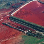 The damaged reservoir near an alumina plant is seen from the air in Kolontar, 150 km (93.2 miles) west of Budapest, October 9, 2010. Hungary's premier warned on Saturday that the wall of a damaged industrial reservoir was likely to collapse, threatening a second spill of toxic red sludge, and a nearby village was evacuated as a precaution. REUTERS/Laszlo Balogh (HUNGARY - Tags: DISASTER BUSINESS ENVIRONMENT) - RTXT8D8